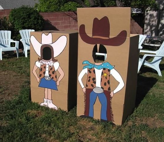 Photo props at a Cowgirl Party and can do it with any theme. Good use of big appliance boxes!