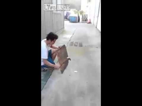 Real Funny   Guy hits cell phone battery with a hammer which results in an explosion and raining fire balls.