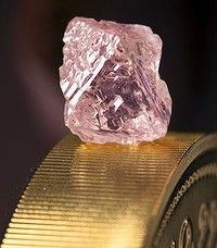 """Mining giant Rio Tinto said it has unearthed a """"remarkable"""" 12.76 carat pink diamond in Australia, the largest of the rare and precious stones ever found in the resources-rich nation.  Named the Argyle Pink Jubilee, the huge rough stone was found at Rio's pink diamond operations in the Kimberley region of Western Australia.    Read more: http://www.smh.com.au/executive-style/luxury/huge-rare-pink-diamond-found-in-wa-20120222-1tnjs.html#ixzz1rkDAU8Mk"""
