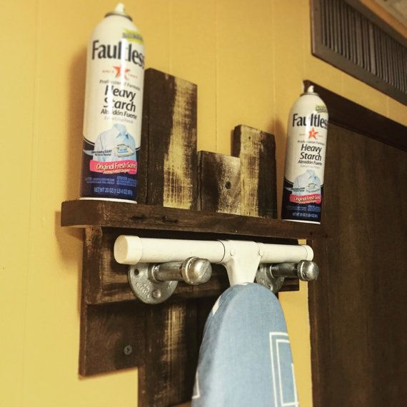 For purchase we have our famous Industrial Pallet Ironing Board Holder! If youre looking to organize space, while adding an industrial touch to a
