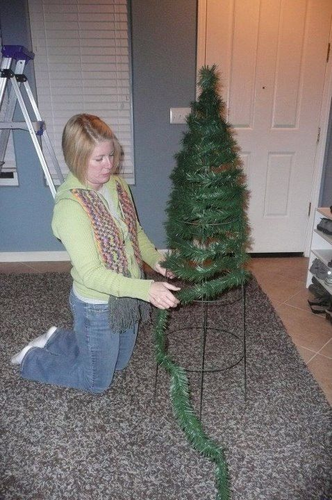 Tomato cage Christmas Tree. Garland, lights, and decorate. Use on the front porch, up on a table. It is cute and easy.
