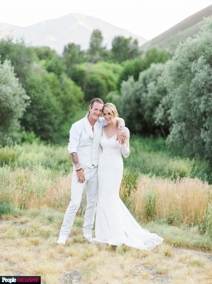 Tyler Hubbard + Hayley Stommel's wedding captured by Troy Grover Photographers, shared exclusively by People Magazine.  The wedding was photographed with a mixture of film & digital, the latter edited with Mastin Labs Fuji 400H.