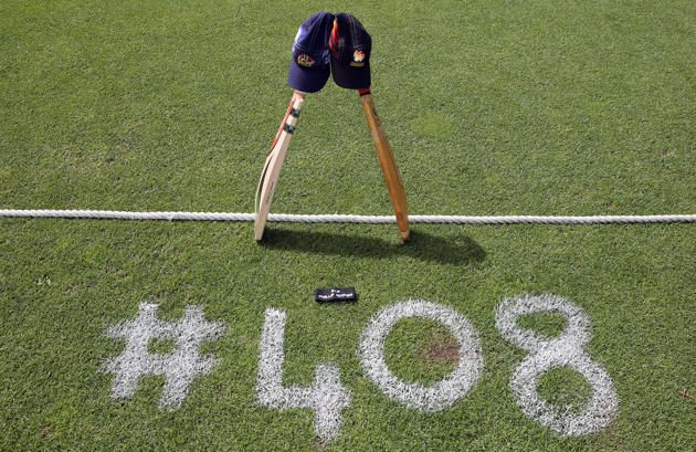 The Otago Volts and Wellington Firebirds place a bat, cap and black armband on the University Oval in memory of Australian cricketer Phillip Hughes who passed away as a result of head injuries sustained during the Sheffield Shield match between South Australia and New South Wales at the SCG on Tuesday above number 408 which was his selection number for Australia during the Georgie Pie Smash T20 match between .