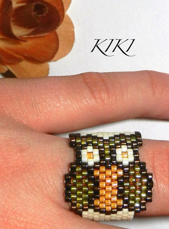 Peyote beaded ring with owl pattern in band style by KikisBeadArt