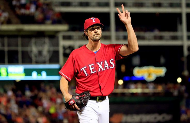 Hello, Texas -  New Texas Rangers starting pitcher Cole Hamels waves to the crowd after leaving the game during the eighth inning against the San Francisco Giants Aug. 1 in Arlington, Texas. Hamels left with a lead, but the Giants came back to win 9-7. -  © Kevin Jairaj/USA TODAY Sports