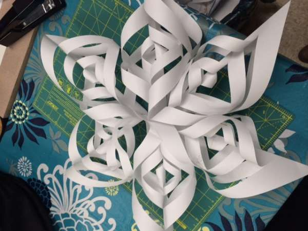 What are some good science projects with paper snowflakes for kids?