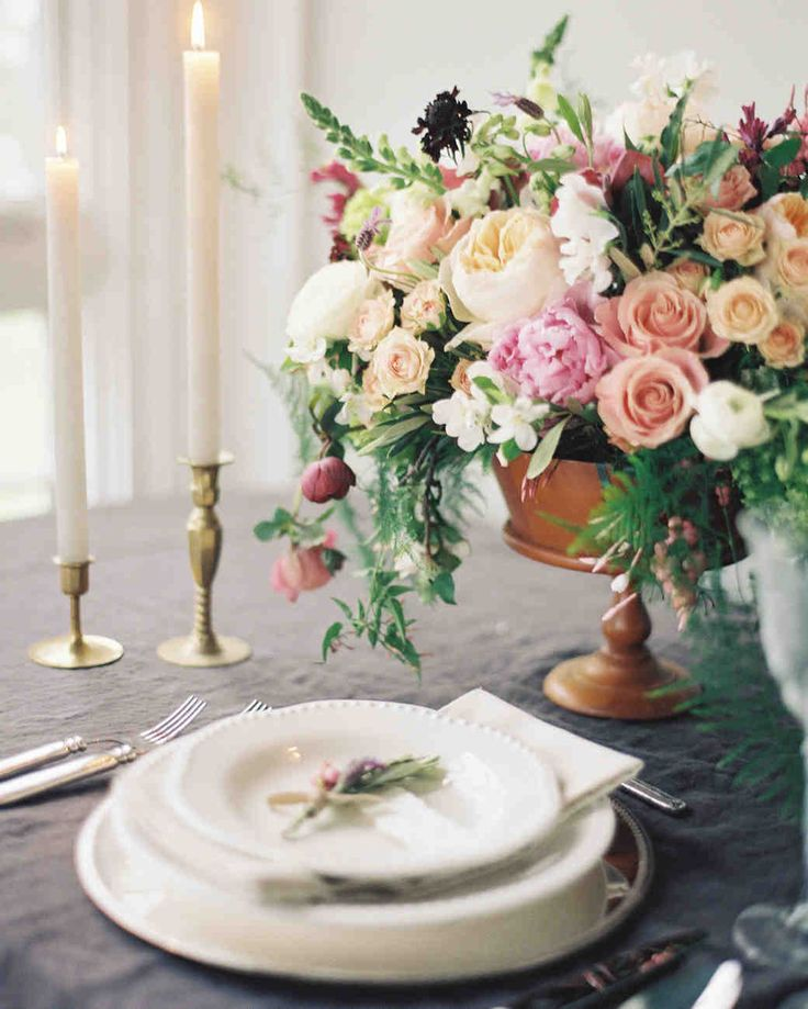 Pink Wedding Centerpieces We Love | Martha Stewart Weddings - A slate gray tablecloth and an oaky receptacle bring a more masculine feel to this pink and cream ranunculus, rose, and peony centerpiece.
