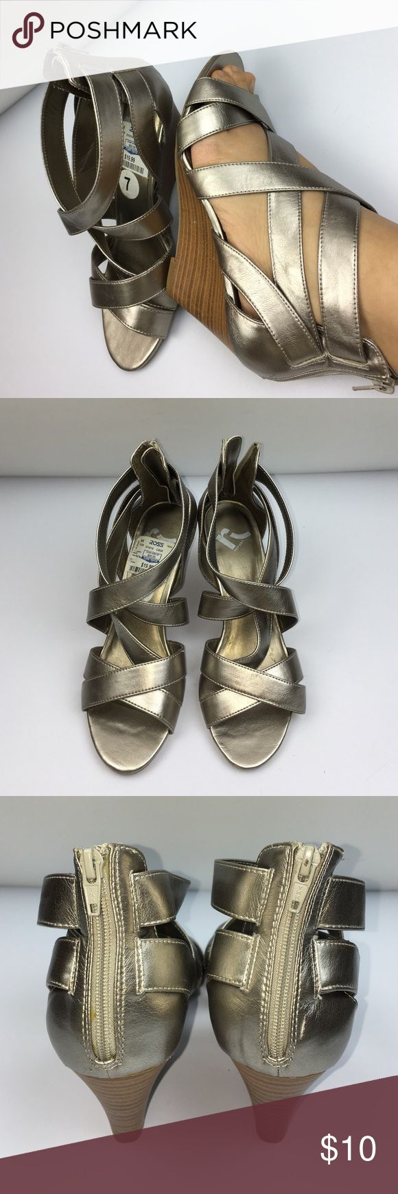 """Strapy metallic wedges. NWT Metallic opened toed, pewter colored, strapy wedges. Zips up the back. 3 inches tall and rubber bottoms. Never worn outside of the house. Only worn to try on. The brand in called, """"Report"""". Purchased from Ross stores and original retail price is $50.00. I paid $20.00 for them. Kept in a box for years. Need to clean my closet out. They need a good home, one who will appreciate them. They are a size 7 but are not true to size. They are more like a 7 & 1/2. Report…"""