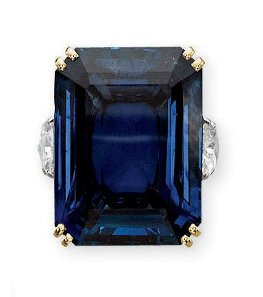 A SAPPHIRE AND DIAMOND RING, MOUNTED BY CARTIER   Set with a rectangular-cut sapphire weighing 47.79 carats to the pear-shaped diamond shoulders, ring size 6¾, with French assay marks for gold and platinum  Signed Monture Cartier