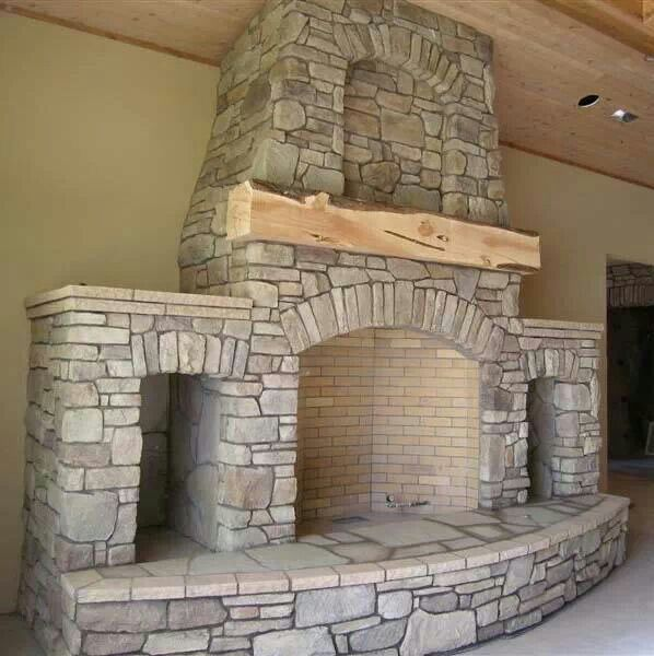 Stone fireplace with wood storage. Id rather have larger wood storage ...