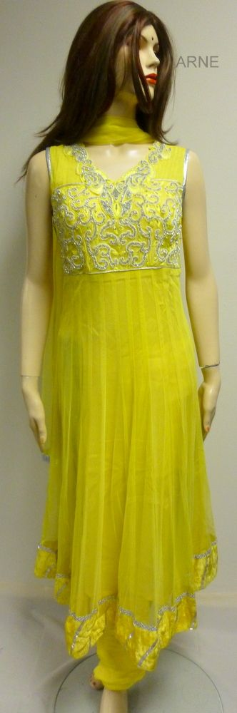 Size 40  -Yellow soft net anarkali with diamond stone embellishment around the neck  - silk chudidar and net yellow dupatta  - Sleeves attached