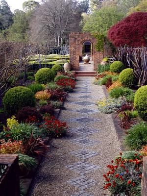 Mosaic and gravel path and topiary
