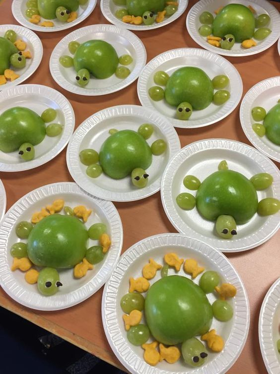 Cute turtle snack made from apples and grapes. Add some chocolate chips for eyes and attach with a little cream cheese or frosting. Fun with Goldfish crackers too!