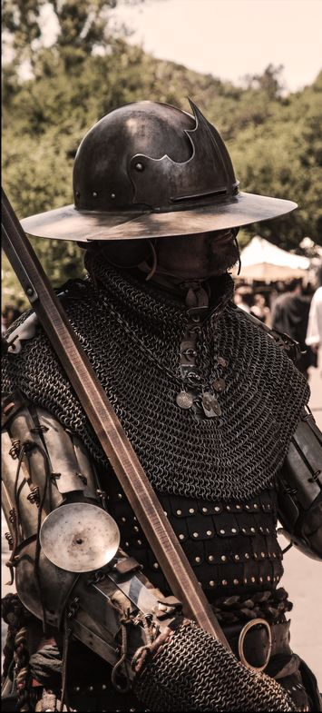 Faires all over California and Arizona, Armor sets / with friends.  Armored German mercenarie, David Bobrink medieval weapons and armor, poleaxe hammer, gambeson, Brigandine, Bishop's mantel, splint upper arms, splint bracers, chainmail gloves, visored kettle hat.