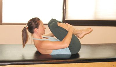 Learn Pilates Double Leg Stretch: Exhale: Curl Up