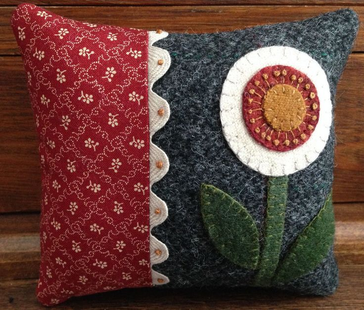 This little pincushion/pillow kit is so sweet and wonderful with all kinds of little details! The folk art flower is highlighted against a dark wool. The kit includes all of the wool, red cotton fabric, ric rac, cotton backing, color photo and directions. Finished size is 5 x 5 1/2.  This comes from a smoke free home.