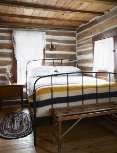Simple and contemporary almost, re Muskokas, 1935 log cabin (bedroom detail, with HBC blanket)