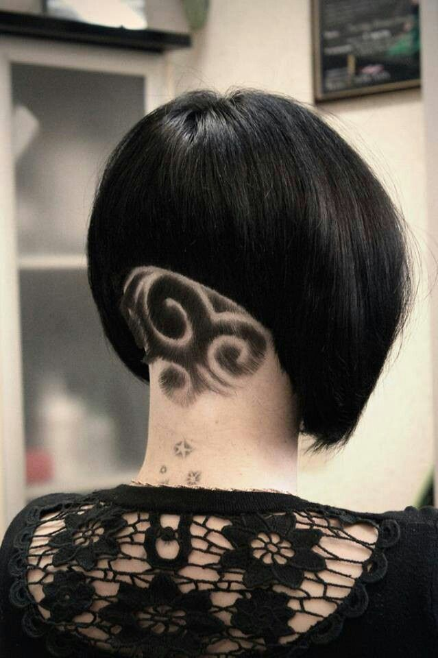Angled bob. Shaved pattern in nape.