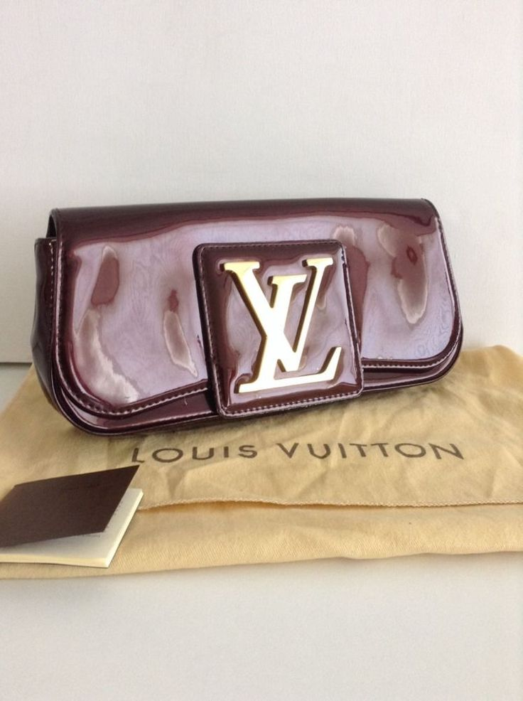 Louis Vuitton Amarante leather Sobe Clutch / bag