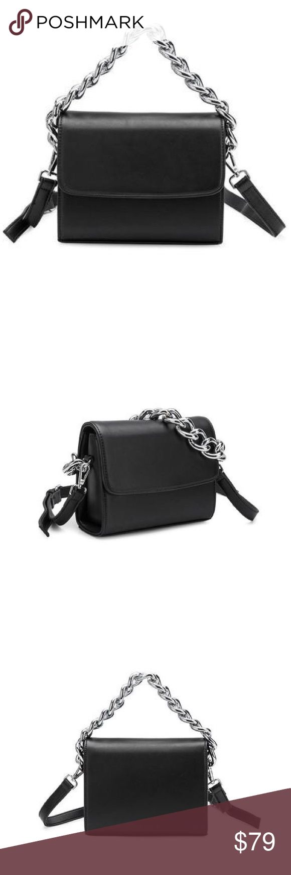 """Elle Chain Handbag The Elle Chain Handbag is adorned with a chrome thick chain shoulder strap and gorgeous premium vegan leather body.  * Premium Vegan Leather * PETA Approved * Eco-Luxe Lining * Magnetic Flap Closure * Inside Pockets * Includes Long Adjustable Crossbody Strap * Chrome Hardware * 8""""L x 7""""W x 2.5""""H * Black Vegan Leather Melie Bianco Bags Shoulder Bags"""