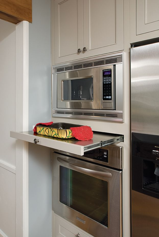 A must-have resting place between a microwave and a wall oven - a stainless steel wrapped shelf that looks just as much in place when closed
