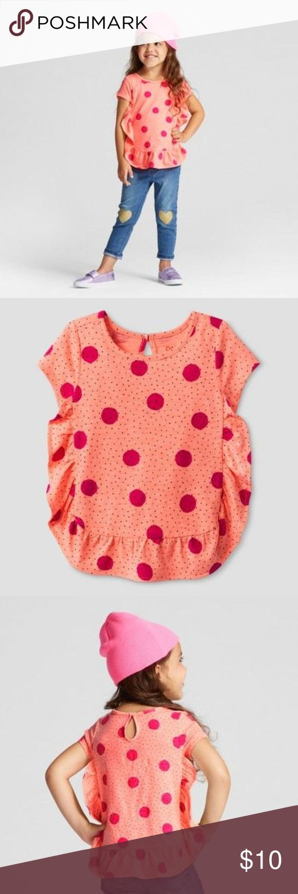 New CAT & JACK Moxie Peach Polka Dot Top Your girl will love showing off her cool style even when she's keeping her look comfy and casual with the Short-Sleeve T-Shirt from Cat and Jack. This peach T-shirt adds a fun flair with the ruffled detail, polka dots and keyhole cutout on the back. When she's just hanging out, she'll love pairing this shirt with jeans and sneakers.  available in size 12M | 18M | 2T condition: new without tags color: moxie peach  @cjrose25 Cat & Jack Shirts & Tops…