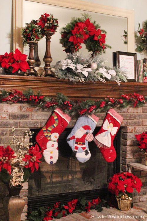 Christmas fireplace mantel with poinsettias