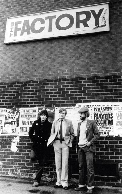 Peter Saville, Tony Wilson and Alan Erasmus, in front of The Factory Club (Russel Club), Hulme, 1979, by Kevin Cummins