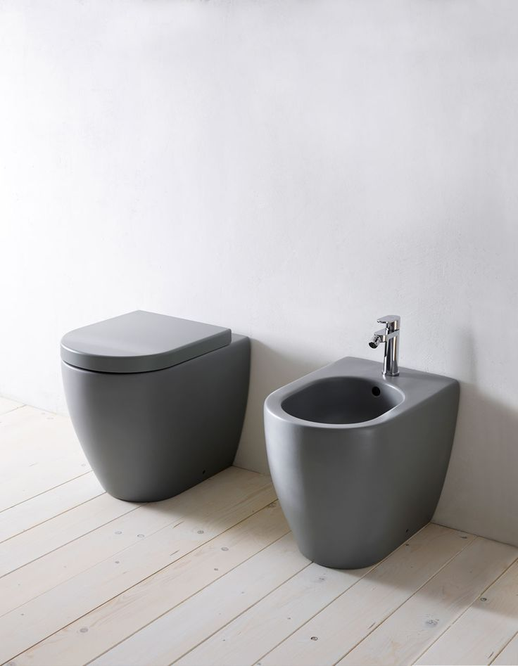 "CIELO's Smile Collection: young appeal, easy-chic, just like the name suggests. Greatest functionality and attention to design are its strength. In the photo, floor mounted wc and bidet are proposed in Brina finish from the ""Terre di Cielo"", the all-new range of finishes inspired by the colors of the dirt, plants, natural elements and minerals. #Cielo #handmade #ceramic #bathroomdesign #madeinitaly"