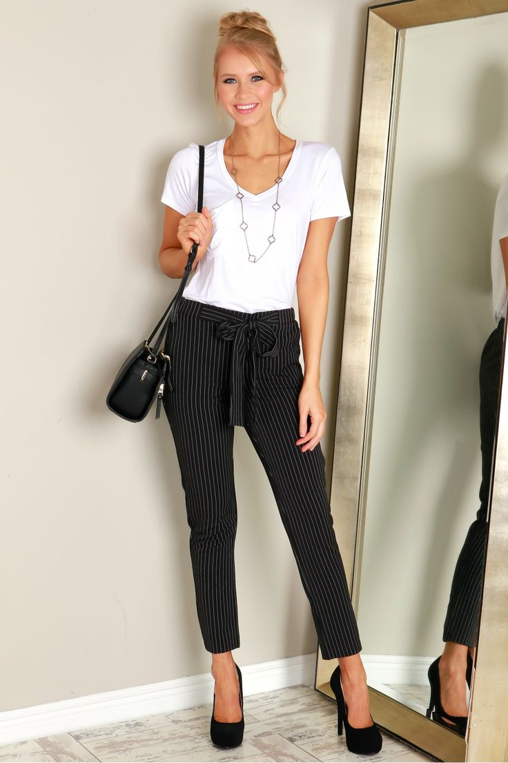 Pin Stripe Chiffon Pants Black, Stay business chic in these pin stripe pants that exhibit a chiffon material, an elasticized waist, a two pocket construction, and a built in belt which ties in front.