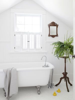 great Rejuvenation website for all vintage lights. hardware, decor; Eastlake plant stand pops against tub and white subway tiles Read more: Soapstone Sink - Bathroom Decor Pictures - Country Living