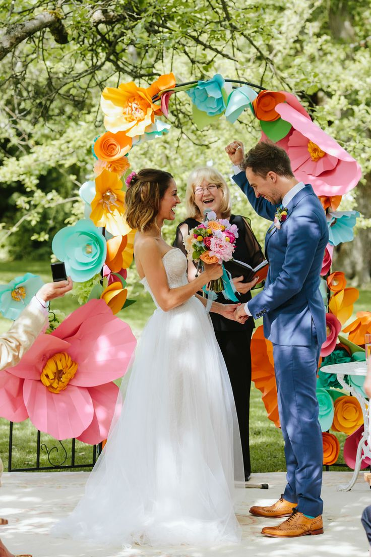 DIY Bright Colourful altar Decor | Vibrant Outdoor Blessing | Marquee Reception | Colourful Streamer Decor | Intimate Town Hall City Ceremony & Pub Lunch | Two Wedding Dresses | Mint Green Jimmy Choos | Images by Craig Williams | http://www.rockmywedding.co.uk/suzannah-james/