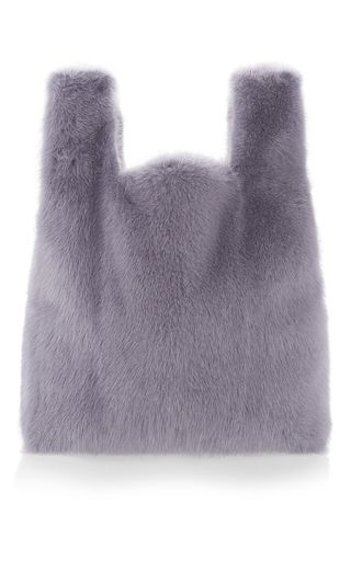 This **Simonetta Ravizza** tote from the Furrissima collection is rendered in fox fur and features a powder tone and straps.