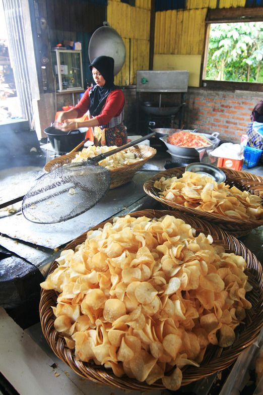 The making of Kripik Sanjay or spicy cassava crackers originated from Sanjay Village in Bukittinggi. Photo by Indra Febr...