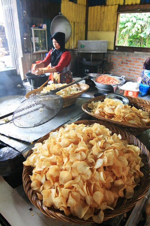 The making of Kripik Sanjay or spicy cassava crackers originated from Sanjay Village in Bukittinggi. Photo by Indra Febr...