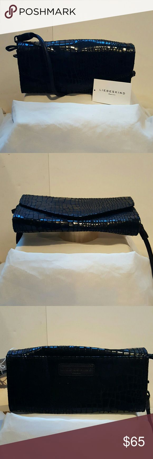 Liebeskind Black Doro Clutch Soft lather, outside pocket and removable strap turns it into a clutch or crossbody. Snap closure, 3 seperate interior sections and one zippered large pocket. 10x1x5 Liebeskind Bags Clutches & Wristlets
