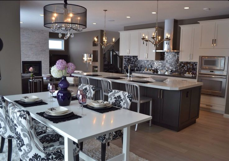 im obsessed with this black and white kitchen with hard wood floors and a tint of purple.. dying