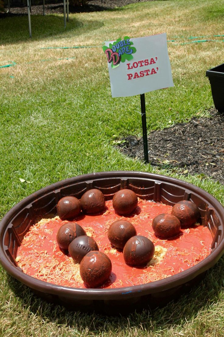 Bought a $10 baby pool, spray painted brown. Bought mini footballs from dollar tree & spray painted those for the meatballs. I actually boiled a couple five gallon buckets of pasta and used real spag sauce. Flag was buried deep in pool.