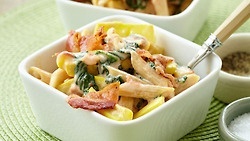 BLT-rific Mac and Cheese by Dash    Ingredients:    3 slices center-cut bacon or turkey bacon4 1/2 oz (about 1 1/2 cups) uncooked high-fiber penne pasta2 large yellow summer squash3 cups chopped spinach leaves1 large tomato, seeded and chopped2 Tbsp fat-free sour cream2 slices fat-free cheddar cheese4 wedges The Laughing Cow Light Creamy Swiss cheeseSalt and black pepper (optional    DIRECTIONS:    1. Cook bacon until crispy, either in a large skillet over medium heat or on a microwave-safe…