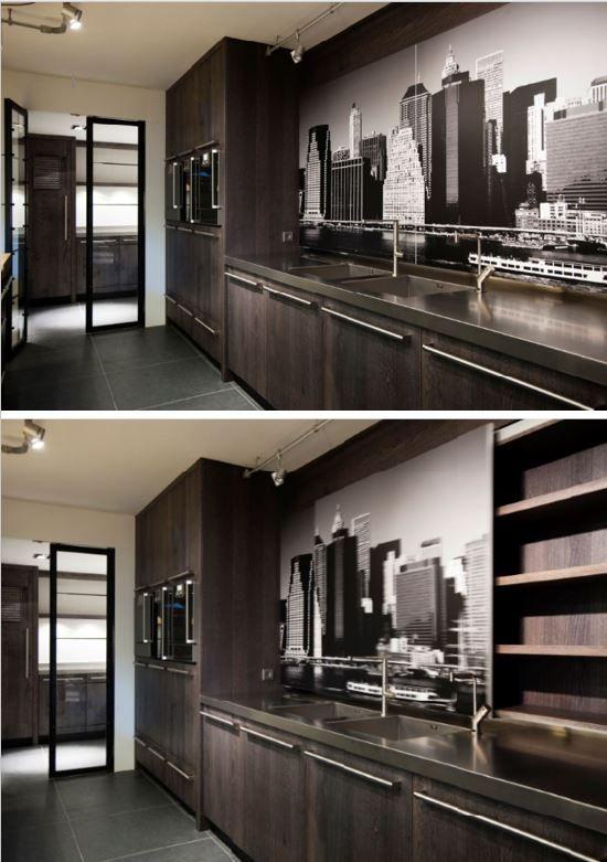 Massief 3-laags eikenhouten keuken, afwerking Ala The Living Kitchen by Paul van de Kooi. Achter de New York deuren bevinden zich eiken legplanken. RVS aanrechtblad met ingelaste spoelbakken. Apparatuur van Gaggenau.