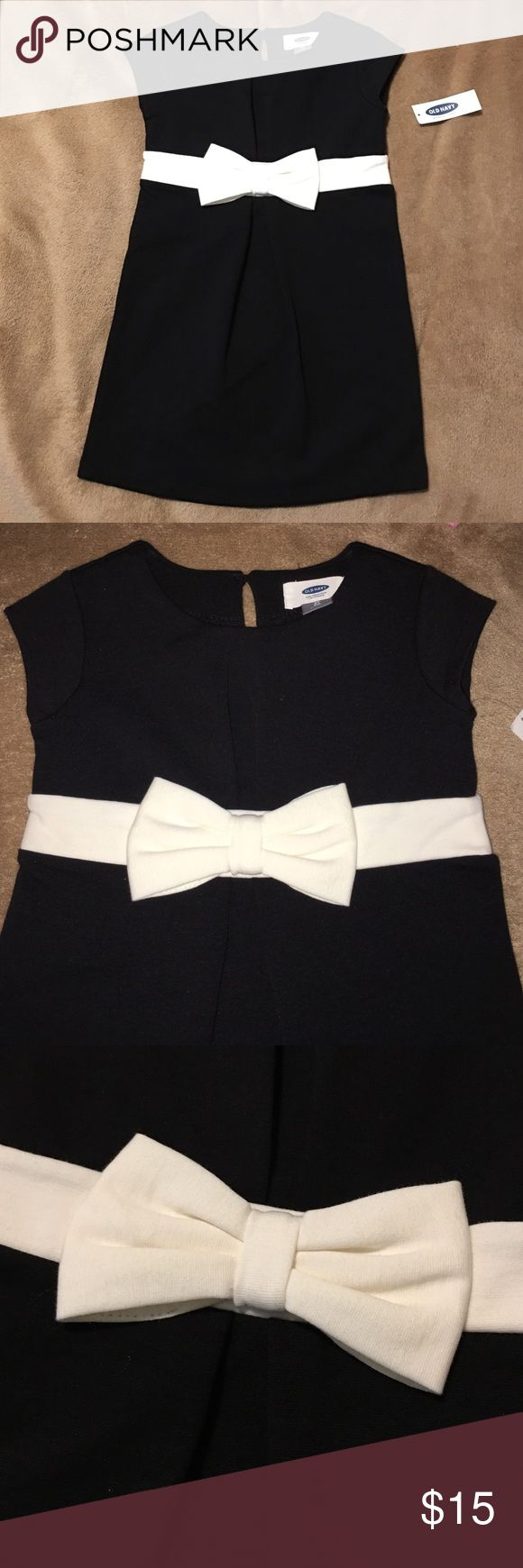 Black and white toddler dress So disappointed my little one outgrew this before she could wear it! It is vintage reproduction by Old Navy! Black dress with a little white bow around the waist. Old Navy Dresses Formal