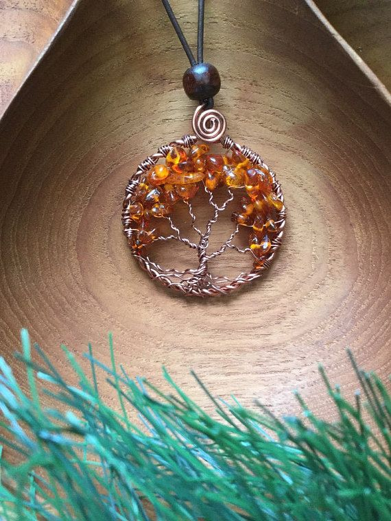 This Tree Of Life Pendant was made on colored copper wire, using Amber as the leaves. It is a beautiful Autumn pendant. It has an adjustable brown leather cord. Below is what some say about Amber This is what is said of Amber: A Bright sunny day, the energy of Amber is used to transmute