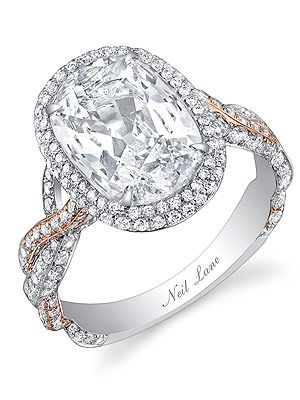 Naya Rivera's engagement ring.   A large oval-shaped diamond set in a braided rose gold, platinum and pavé diamond band.