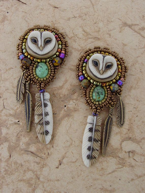 These sweet little owl earring are made using Laura Mears amazing owl face and feathers. I added a turquoise cabochon, glass beads and
