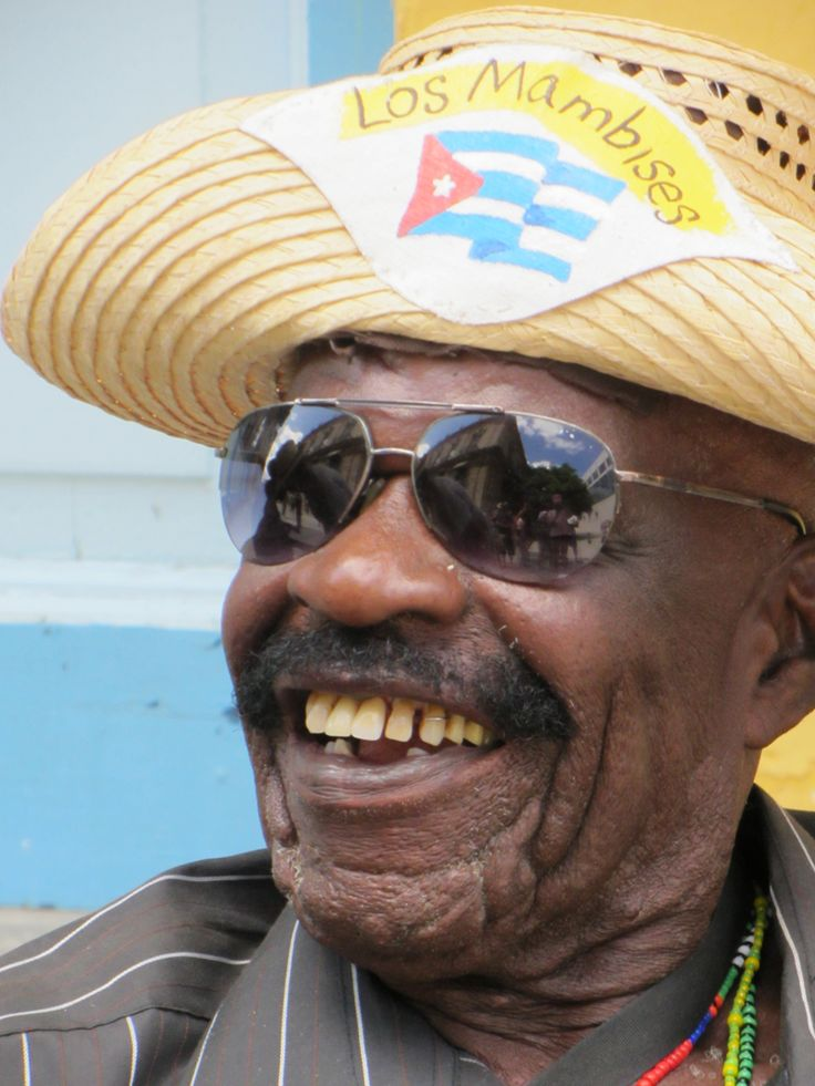 Cuban musician - the smile is as warm as the climate.