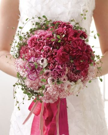 Carnation bridal bouquet in vibrant shades of pink (carnations -- go figure!)