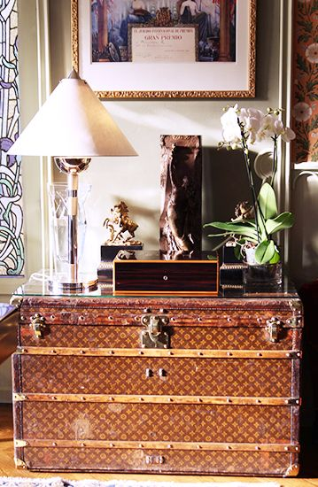 Vintage Louis Vuitton trunk transformed into a piece of furniture. It adds luxury without being over the top