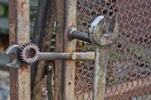 Old wrenches used for gate handle & lock. Eclectic exterior by Louise Lakier.