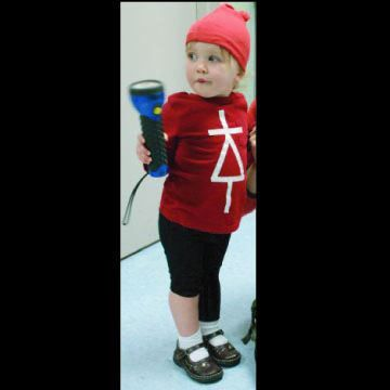 All you need is a flashlight, some tape, and a matching hat and shirt. Decorate the shirt with a diode symbol, roll up one pant leg (cathode...