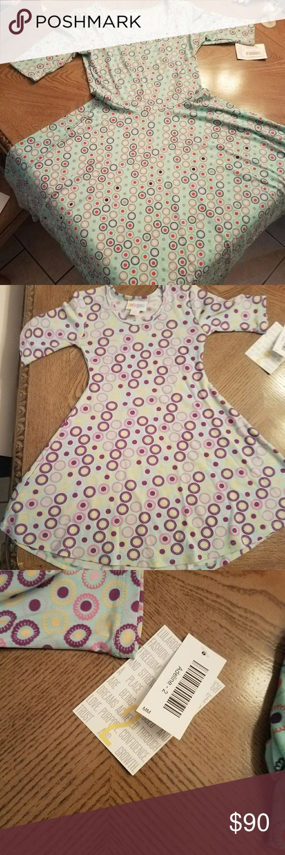 LuLaroe S Nicole & size 2 Adeline mommy & me Both NWT in slinky material Look stunning with your daughter in matching LuLaroe fashion were. I am not a consultant and therefore pay full retail for my clothing. LuLaRoe Dresses Midi